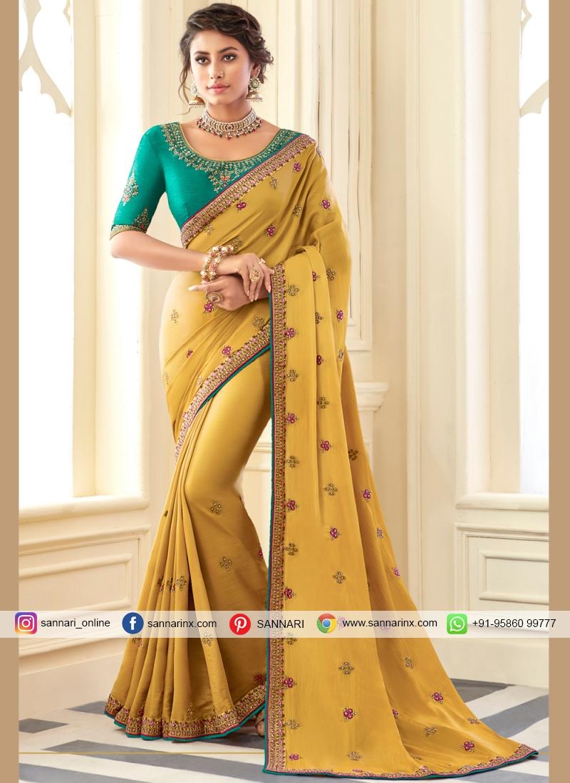 Desirable Mustard Zari Classic Designer Saree