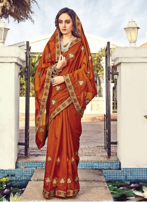 Dignified Silk Rust Embroidered Traditional Designer Saree