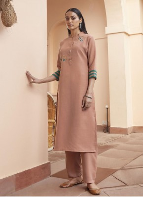 Fancy Fabric Peach Embroidered Party Wear Kurti