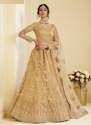 Honourable Net Embroidered Gold Lehenga Choli