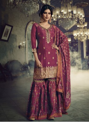 Hypnotizing Jacquard Silk Embroidered Designer Pakistani Suit
