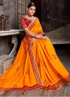 Mesmerizing Orange Patch Border Fancy Fabric Designer Saree